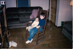 Wesley Teel and her brother Matthew in a rocking chair in their house in Amelia Ohio